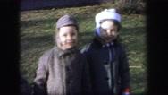 1974: three children in warm coats outside in winter gusty wind LYNBROOK Stock Footage