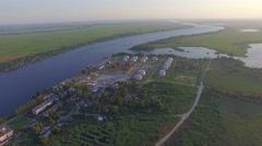 Flight over oil plant near the river Stock Footage