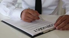 Businessman signing contract text hand agreement items Stock Footage