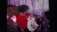 1974: the whole family visiting the new baby on return home at christmas Stock Footage