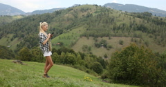 Young Beautiful Blonde Woman Browsing Internet on Mobile Phone Mountain View Day Stock Footage