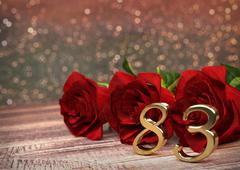 Birthday concept with red roses on wooden desk. eighty-third. 83rd. 3D render Stock Illustration