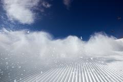 Snow dust cloud after skier on the ski slope Kuvituskuvat