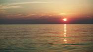 Seascape. Sunset. Calm sea in the light of setting sun. Wide angle. HD Stock Footage