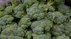 Pile of broccoli at market Stock Footage