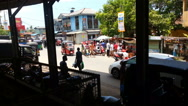 Busy traffic near Weligama railway station, taxi drivers, people in the street Stock Footage