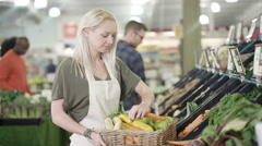 4K Portrait friendly worker in grocery store turns to smile at camera Stock Footage