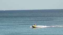 Young Man and Son on Jet Ski, Tropical Ocean Stock Footage