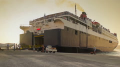 Ferry boat passenger ship loading people and vehicles for a trip. Stock Footage