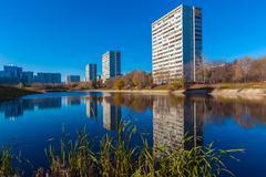Modern apartment houses near pond, Moscow Stock Photos