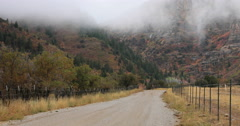 Rural mountain road canyon autumn storm fast DCI 4K 428 Stock Footage
