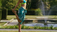 Young woman doing yoga poses in a park Stock Footage