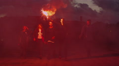 Group of Happy Teenagers with one Holding and Waving with Signal Flare Stock Footage