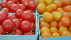 Red and yellow cherry tomatoes at market Stock Footage