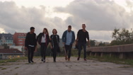 Group of Five Happy Teenagers Walking Forward Towards Camera Stock Footage