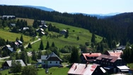 Small village in the nature between forests - sunny day - closeup Stock Footage