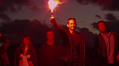 Group of Happy Teenagers with one Holding and Waving Signal Flare Stock Footage