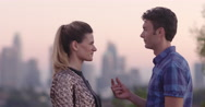 Young man proposing to girlfriend in Los Angeles at sunset 4K Stock Footage
