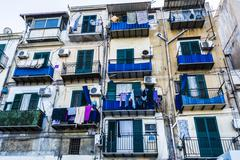 Building exterior with windows and balconies in Palermo, Italy Stock Photos