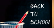 Pencil container and blackboard frame with written back to school Stock Footage