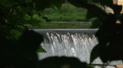 Waterfall in a frame of leaves Stock Footage