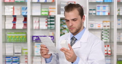 Pharmacist Man Analyzing Prescription Medicine Box Info Drugs Leaflet Pharmacy Stock Footage