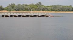 Work pontoon bridge on the river Oka,Russia, Nizhny Novgorod region Stock Footage