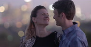 Attractive couple laughing with each other in city park at dusk 4K Stock Footage