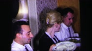 1974: family sits down for dinner and a woman steals bread from a tiny sailor Stock Footage