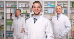 Group of Happy People Pharmacists Looking Camera Smiling Portraits Pharmacy Shop Stock Footage