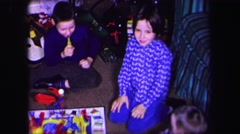 1974: children are seen indoors playing LYNBROOK, NEW YORK Stock Footage