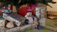 Snowman under new year tree close-up Stock Footage