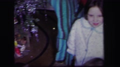 1974: three children in their pajamas playing happily with their train set Stock Footage