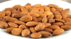 Almond rotating on a white plate. Seamless loopable. Prores 4K Stock Footage