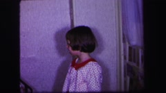 1974: beautiful kids with nice dressings are playing near to a staircase Stock Footage