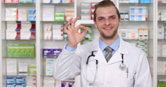Smiling Pharmacist Man Hand Gesture OK Sign Pharmacy Presentation Looking Camera Stock Footage