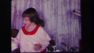 1974: a family on an early christmas morning opens presents  Stock Footage