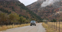 Rural mountain road pickup truck autumn storm DCI 4K Stock Footage