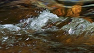 Detail of flowing water - river in the forest Stock Footage