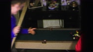 1974: two young boys playing a game of pool on a small billiards table LYNBROOK Stock Footage