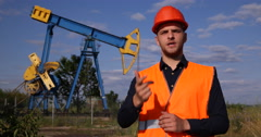 Engineer Man Speak Oil Pump Presentation Petrochemical Production Looking Camera Stock Footage