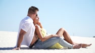 Loving couple lying on the sand in the desert Stock Footage