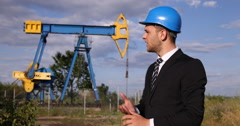Businessman Talking About Oil Pumps Explain Extracting Technology Looking Camera Stock Footage