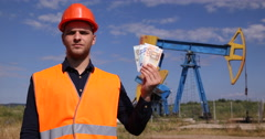 Oil Pump Presentation Engineer Man Showing Euro Bill Looking Camera Pumping Unit Stock Footage
