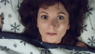 4k Authentic Shot of a Girl in Bed Sleeping and having Nightmare Stock Footage