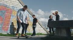 Skateboarder Performing Kickflip for His Teenager Friends. Stock Footage