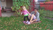 Young mother and her toddler girl have fun in autumn Stock Footage