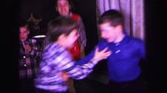 1974: fast motion video of five children and one adult dancing LYNBROOK Stock Footage