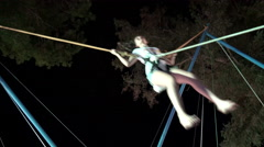 Girl bungee jumping in trampoline Stock Footage