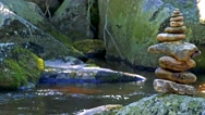 River in the forest with stones - tower of stones  Stock Footage